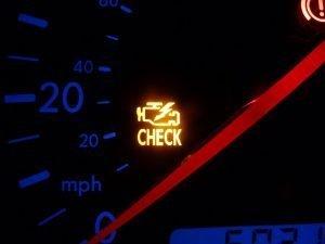 Check engine light on car dashboard illuminated