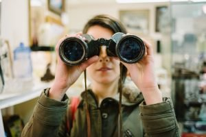 Women holding binoculars