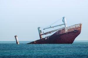 Sinking boat in the ocean in Cythera, Greece