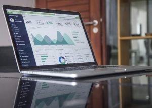 Analytics dashboard on laptop screen on desk