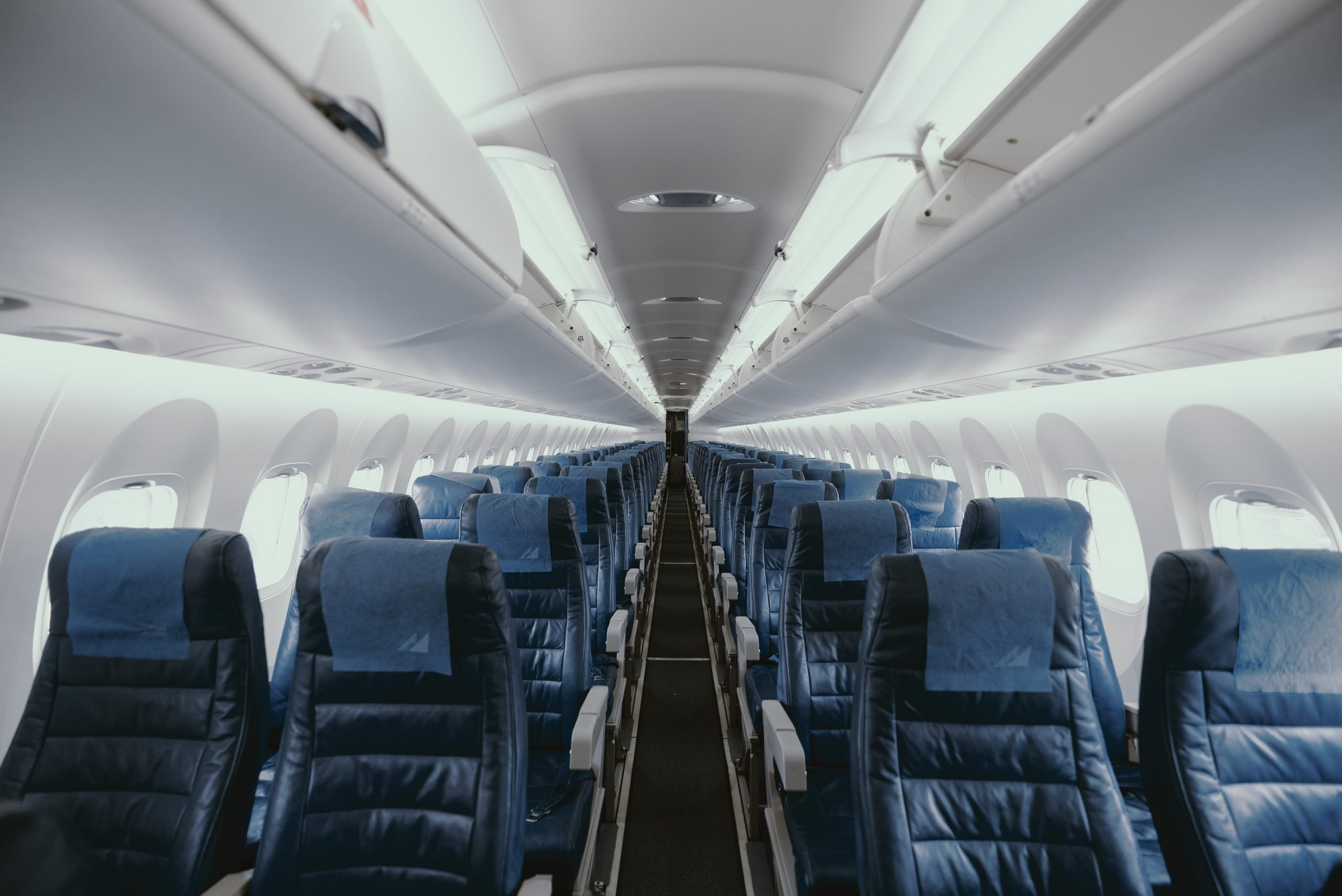 Inside view of empty airliner by JC Gellidon